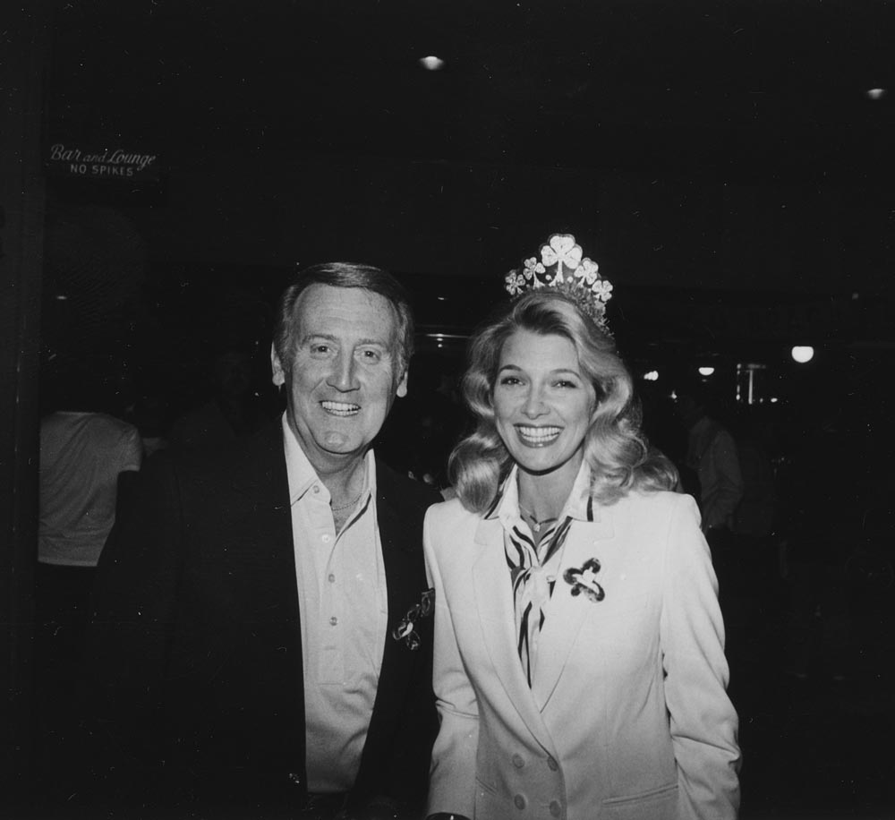 (L-R) Vin Scully; Mrs. Sandi Scully, circa early 1980s.<br /><br /> Hall of Fame sportscaster Vin Scully, the greatest of all time in his field, is with his wife, Sandi Scully, at the traditional St. Patrick's Day Party at Dodgertown in Vero Beach, Florida.
