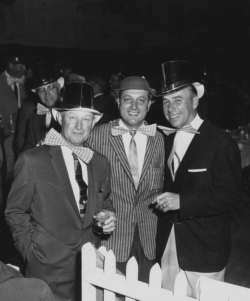 (L-R) Dodger coach Charlie Dressen; Future Dodger Hall of Fame Manager Tom Lasorda; Hall of Fame shortstop Pee Wee Reese, circa 1959.<br /><br /> Future Dodger Manager Tom Lasorda is with a former Dodger Manager Charlie Dressen and recently retired as an active player, Pee Wee Reese as they are dressed for the traditional St. Patrick's Day Party in Dodgertown in Vero Beach, Florida.