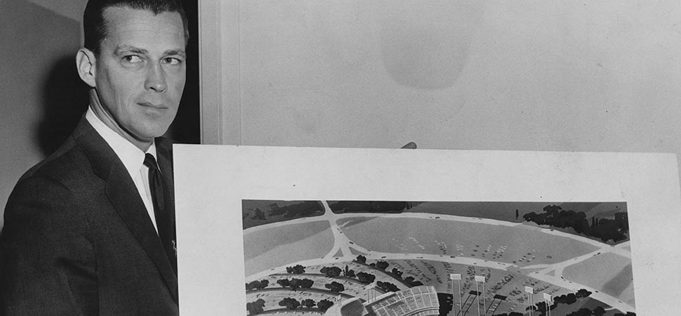 Los Angeles Dodger Vice President of Stadium Operations, Dick Walsh, displays an early iteration of the new Dodger Stadium to be built in Los Angeles. Note the lack of pavilion seats in this model. The final version of Dodger Stadium had pavilions for fan seating in left field and right field.