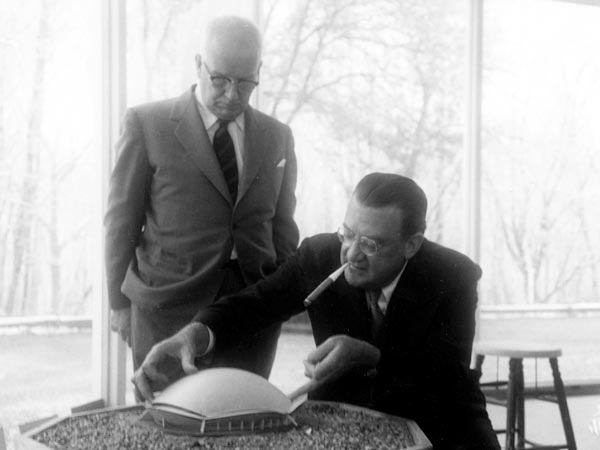 Buckminster Fuller (left) confers with Dodger President Walter O'Malley in 1956 regarding the use of a geodesic dome to contain a new baseball stadium in Brooklyn. Fuller, an internationally known inventor, designer, and professor, was a judge at a competition for architectural students at Princeton University and O'Malley was present to review student designs for a baseball stadium.