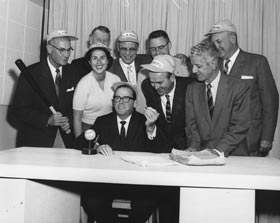 A proud day indeed for Los Angeles, as its Mayor Norris Poulson and City Council members celebrate the Dodgers acceptance of the city's contract offer on October 8, 1957. First row behind Poulson (left to right) are council members Ransom Callicott, Roz Wyman, Gordon Hahn and Charles Navarro, while behind them (left to right) are John Gibson, L.E Timberlake, James Corman and Everett Burkhalter.