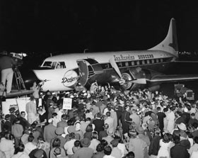 The Dodger Convair 440 airplane arrives at the Los Angeles International Airport carrying club executives and select players as the welcoming committee is ready to greet the contingent on October 23, 1957. Because of strong headwinds, which necessitated a fuel stop, the plane arrived more than two hours late, but it did not put a damper on the celebration as bands played and the Dodger personnel were properly welcomed to their new home. Wyman meets O'Malley for the first time on the steps of the airplane.