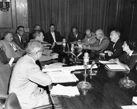Members of the Los Angeles City Council in discussions with the Dodgers: (L-R) John Holland, Harold Henry, Patrick McGee, Karl Rundberg, Ernest Debs, Jim Corman, Ransom Callicott, Gordon Hahn, Everett Burkhalter, along with Dodger Counsel Henry J. Walsh, and Councilwoman Roz Wyman.