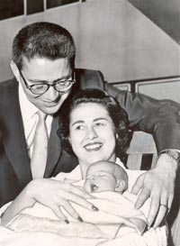 Proud parents Eugene and Roz Wyman are all smiles on the birth of daughter Betty Lynn on April 5, 1958. Thanks to Councilwoman Wyman's leadership, the first Dodger game played in Los Angeles took place on April 18 at the Memorial Coliseum.