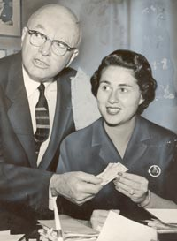 Councilwoman Roz Wyman buys tickets for the St. Louis Hawks-Philadelphia Warriors basketball game at new Los Angeles Sports Arena on September 30, 1959 from Arthur Pollack, chairman of the L.A. Newspaper Publishers Association. Wyman was also instrumental in bringing the Lakers from Minneapolis to Los Angeles.