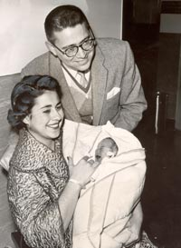 Roz and Eugene Wyman are all smiles and the proud parents of newborn son, Robert Allen, at Cedars of Lebanon Hospital on January 17, 1960.