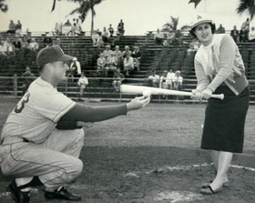 Dodger right-hand pitcher Don Drysdale pitches a baseball to Roz Wyman at Holman Stadium, Dodgertown in Vero Beach, Florida. Wyman took some powerful swings off Drysdale's underhand tosses and hit the baseball solidly.