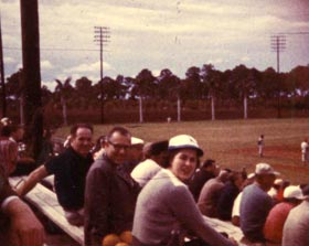 Roz Wyman watches an exhibition game at Holman Stadium during Spring Training at Dodgertown in Vero Beach, Florida in March, 1959.