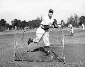 Walter Alston, who was named Dodger Manager by Walter O'Malley for the 1954 season, throws batting practice. Alston was a successful minor league manager in the Dodger system, before his promotion.
