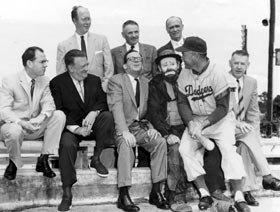 Los Angeles elected officials visit Dodgertown to meet with Walter O'Malley on March 6, 1957 with hopes of hooking the major league team for their city. Front row (l-r) Los Angeles County Supervisor Kenneth Hahn, Walter O'Malley, Los Angeles Mayor Norris Poulson, famous clown Emmett Kelly, who was at Dodgertown to entertain fans during the spring, Dodger center fielder Duke Snider and City Council President John Gibson.