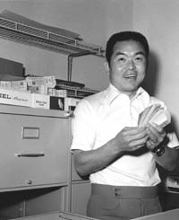 """Akihiro """"Ike"""" Ikuhara, a graduate of Waseda University in Japan, working in the Dodger ticket office. Ikuhara learned the business of baseball from the O'Malleys and became a goodwill ambassador and interpreter for the Dodgers. In summer of 2002, Ikuhara was posthumously inducted into the Japanese Baseball Hall of Fame."""