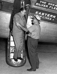 Airport manager Bud Holman (right) welcomes Walter O'Malley to Vero Beach as spring training activities begin at Dodgertown. Holman, an Eastern Air Lines director, initially contacted Branch Rickey and the Dodgers about using the barren U.S. Naval Air Station as a spring training home.