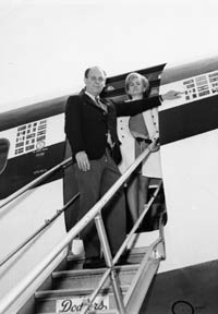 """Capt. Lew Carlisle takes the reins as pilot of the Dodger airplane in 1965 from Capt. H.R. """"Bump"""" Holman. Capt. Carlisle and his wife Millie were friends of many at Dodgertown."""