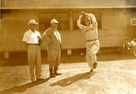 "Dodger President Branch Rickey, the ""father"" of the player development system, Dodger Manager Burt Shotton, known for wearing civilian clothes in the dugout and a pitcher at Dodgertown."