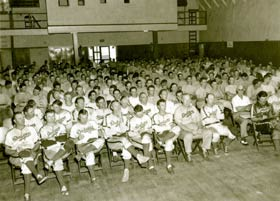 Dodger players attend a baseball skills class in the old Dodgertown auditorium. Branch Rickey's initial vision for a training camp included educating the players about all aspects of the game.
