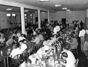 Dodgertown's mess hall is the gathering point for all hungry players, staff and executives. But, feeding the masses cafeteria style meant waiting in line and eating in shifts. Walter and Kay O'Malley stood in line holding their aluminum trays shoulder to shoulder with the players.