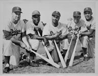Duke Snider (left to right), Jackie Robinson, Roy Campanella, Pee Wee Reese and Gil Hodges are at Dodgertown in Vero Beach, FL (circa 1955) preparing for the season. All five stars made an indelible mark in Dodger history. Snider, Robinson, Campanella and Reese all were enshrined into the National Baseball Hall of Fame, while Hodges has received the most cumulative votes for any player who has not been elected into the Hall of Fame.