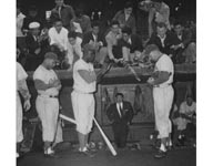 Following their 1956 National League Pennant-winning season, the Dodgers made a goodwill trip to Japan to play 19 games against various Japanese professional teams and All-Star teams. Roy Campanella (left to right), Robinson and Duke Snider give baseball fans in Japan an up close and personal view of the popular Dodgers, as they sign autographs in front of the dugout.