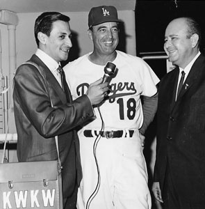 Dodger Spanish-language broadcaster Jaime Jarrin (left) interviews coach Preston Gomez in the mid-1960s, while Jarrin's on-air partner Jose Garcia shares a laugh.