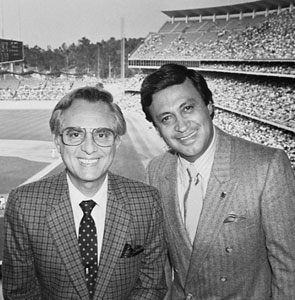Dodger Spanish-language broadcaster Rene Cardenas (left), who helped pioneer games in Los Angeles, first visited Dodgertown in 1959. He is shown at Dodger Stadium with his longtime on-air partner and Hall of Famer Jaime Jarrin.