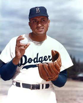 Big Don Newcombe handy with the glove and the bat set the National League for most home runs by a pitcher with seven in 1955.