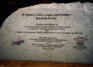 Peter O'Malley, president of the Los Angeles Dodgers from 1970-98, privately built two baseball fields in Ireland, one for youth and one for adults. This is the official stone commemorating the opening of the O'Malley Little League and Dodger Baseball Fields in Corkagh Park, West Dublin, Ireland on July 4, 1998. The stone features writing in Irish Gaelic and English. The Peter O'Malley International Invitational Tournament will be held July 12-14.