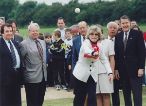 U.S. Ambassador Jean Kennedy Smith throws the first pitch at dedication ceremonies for the O'Malley Little League and Dodger Baseball Fields in Corkagh Park, West Dublin, Ireland. Peter O'Malley (far right), president of the Los Angeles Dodgers from 1970-98, privately built the two fields, opened July 4, 1998, which serve as the centerpiece of baseball in Ireland. From L-R: Aldo Notari0, President of International Baseball Federation; Dr. Creighton Hale, President, Little League Baseball; Ed Piszek, Little League Foundation Trustee; Ambassador Smith; Rod Dedeaux, legendary head baseball coach at USC; and O'Malley.