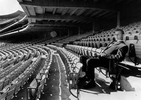 Right-handed star pitcher Don Drysdale tests the new seats at Dodger Stadium. The seats  required 350,000 feet of board lumber, 546 tons of cast iron and 3 tons of aluminum nuts and bolts.