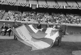 Preparations for pregame ceremonies at Dodger Stadium on Opening Day, April 10, 1962.