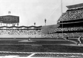 Left-hander Johnny Podres, the hero of the Brooklyn Dodgers' World Series Championship in 1955, christens new Dodger Stadium with its first pitch on April 10, 1962.