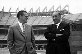 Dodger Vice President Dick Walsh shares a laugh with Jack Yount, the Vinnell Constructors partner in charge of the Dodger Stadium construction project.