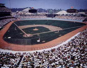A full house at Dodger Stadium watched left-hander Johnny Podres start the first game in Walter O'Malley's new ballpark.