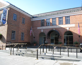 The entrance to the historic National Baseball Hall of Fame and Museum during Induction Weekend, July 25-27, 2008 in Cooperstown, New York. A banner with the images of Dodger owner Walter O'Malley, Manager Billy Southworth and Manager Dick Williams is on display to the far left top side of the photo.<br /><br />Photo courtesy of Brent Shyer