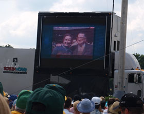 Kay and Walter O&#8217;Malley are displayed on the large video board during the Induction Ceremony of the National Baseball Hall of Fame in Cooperstown, New York. Following the five-minute video presentation about Walter O&#8217;Malley&#8217;s extraordinary life and career, their son Peter O&#8217;Malley accepted the plaque of his father Walter O&#8217;Malley for entry into the National Baseball Hall of Fame.<br /><br />Photo courtesy of Robert Schweppe